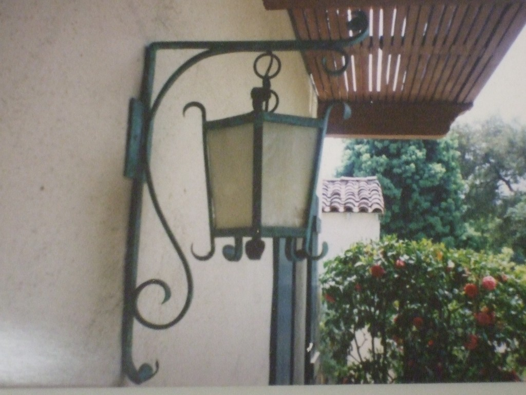 Here is a Custom Made Spanish style light.  Made by Tarbet Landscape